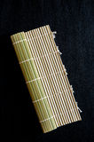 Fabricant matériel en bambou de tapis de rouleau de roulement de sushi images libres de droits