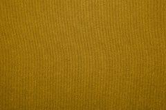 Fabrication d'amende de texture de tissu d'or Image stock