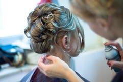 Fabrication de la coiffure Photographie stock libre de droits