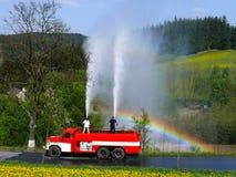 Fabrication de la pluie un jour ensoleillé photos stock