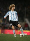 Fabricio Coloccini. Argentinian player Fabricio Coloccini in action during the friendly match between Catalonia and Argentina at Nou Camp Stadium December 29 Royalty Free Stock Photos