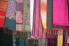 Fabrics. Traditional Thai motley scarfs selling on the market Stock Photo