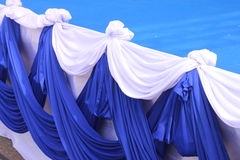 Fabrics arena. Fabrics and folded petals to decorate the stage stock images