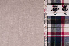 Fabrics background. Linen fabric, plaid flannel shirt with lace Stock Images