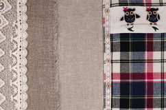 Fabrics background. Linen fabric, sackcloth, plaid flannel shirt Stock Image