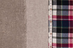 Fabrics background. Linen fabric, sackcloth, plaid flannel shirt Stock Photos