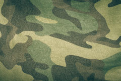 Fabrics with camouflage pattern. Background. Toned.  Royalty Free Stock Photos