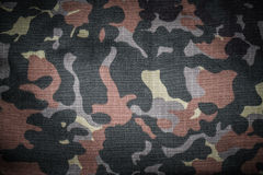 Fabrics with camouflage pattern. Background. Toned Stock Images