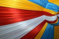 Fabrics decoration. Beautiful colorful fabrics decoration pattern Royalty Free Stock Photo