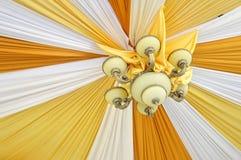 Fabrics decoration. Beautiful fabrics decoration with lamp Royalty Free Stock Photography