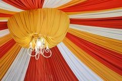 Fabrics decoration. Beautiful fabrics decoration with light on the ceiling Royalty Free Stock Photos