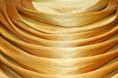 Fabrics decoration. Beautiful luxury golden fabrics decoration Royalty Free Stock Photos