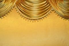 Fabrics decoration. Beautiful luxury golden fabrics decoration Royalty Free Stock Images