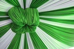 Fabrics decoration. Beautiful white and green fabrics decoration Royalty Free Stock Images