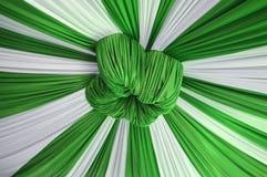 Fabrics decoration. Beautiful white and green fabrics decoration Royalty Free Stock Image