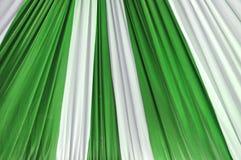 Fabrics decoration. Beautiful white and green fabrics decoration Royalty Free Stock Photo