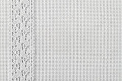 Fabrics for embroidery a cross, lace and ribbons Royalty Free Stock Image