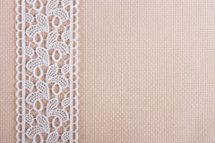 Fabrics for embroidery a cross, lace and ribbons Royalty Free Stock Photos