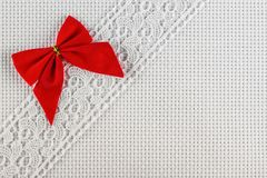 Fabrics for embroidery a cross, lace and ribbons Royalty Free Stock Images