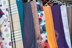 Fabrics hanging at a market stall Royalty Free Stock Images