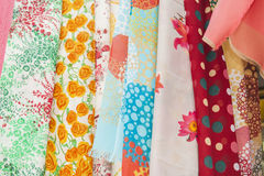 Fabrics hanging at a market stall Stock Photo