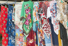 Fabrics hanging at a market stall Royalty Free Stock Image