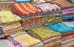 Fabrics at a market stall Stock Photos