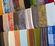 Fabrics at a market stall Stock Photo