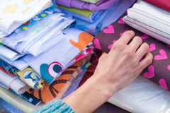 Fabrics on a market stall Stock Image