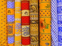 Fabrics of Provence in shop display. Fabrics with prints of Provence on sale in a shop in Arles in France royalty free stock images