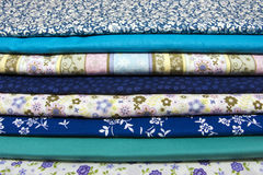 Fabrics for quilting. Pile of blue cotton fabrics for quilting Royalty Free Stock Images
