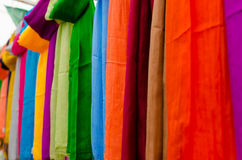 Fabrics rainbow. Coloured palette of various scarfs Royalty Free Stock Images