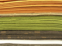 Fabrics stack. Different colours upholstery fabrics stack Royalty Free Stock Images