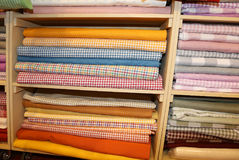 Fabrics of various fantasies for sale in the shelf full of haber. Many fabrics of various fantasies for sale in the shelf full of haberdashery royalty free stock photography