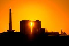 Fabrik Suikerunie am Sonnenaufgang Stockbild