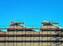 fabriksmaterial till byggnadsställningvägg royaltyfria foton