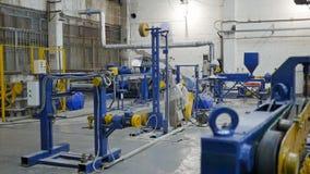 Fabriksseminariuminre och maskiner lager videofilmer
