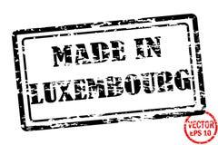 Fabriqué au Luxembourg - calibre du timbre grunged de place noire pour des affaires d'isolement sur le fond blanc Photographie stock libre de droits