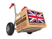 Fabriqué au R-U - camion de boîte en carton en main. Images libres de droits