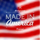 Fabriqué aux Etats-Unis au-dessus du fond defocused de drapeau des Etats-Unis  Images stock