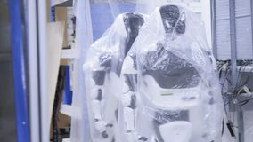 Fabryka dla produkcji roboty, nowożytni mechaniczni rozwoje Kilka roboty są w zapasie w plastikowym opakunku zbiory