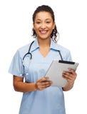 Fabrykuje lub pielęgnuje z komputerem osobistym stetoskopu i pastylki Fotografia Stock