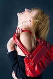 Fabulous. Woman having a red bag over her shoulder and laughing Royalty Free Stock Images