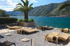 Fabulous beach with wicker loungers on the shore Montenegro Stock Images