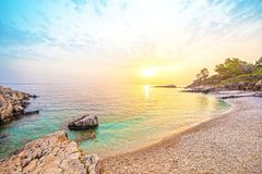 Fabulous beautiful magic landscape with stone at dawn on Bataria Beach on the coast of the Ionian Sea in Corfu royalty free stock photography