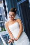 Fabulous bride near the window. Royalty Free Stock Photos