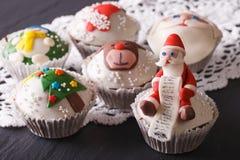 Fabulous Christmas cupcakes with decorations closeup. horizontal stock image