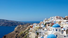 Fabulous city. Architecture Greek cities very distinctive. Comfortable white houses and churches with bright color accents, very nice looking at the background Royalty Free Stock Photo