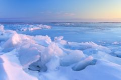 Dawn at the frozen lake shore Royalty Free Stock Images