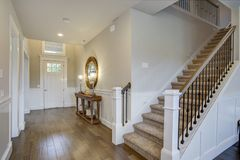 Fabulous foyer features a staircase stock photo